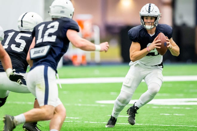 Penn State quarterback Trace McSorley runs a play during the NCAA college football team's practice Wednesday, Oct. 31, 2018, in State College, Pa. (Joe Hermitt/The Patriot-News via AP)