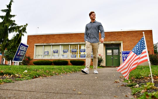 Nicholas Scott, 17, of Dillsburg, is shown at his father, Democratic Congressional candidate George Scott's campaign headquarters in Harrisburg, Thursday, Nov. 1, 2018. The younger Scott will turn 18 on Election Day and plans to cast his vote. Dawn J. Sagert photo