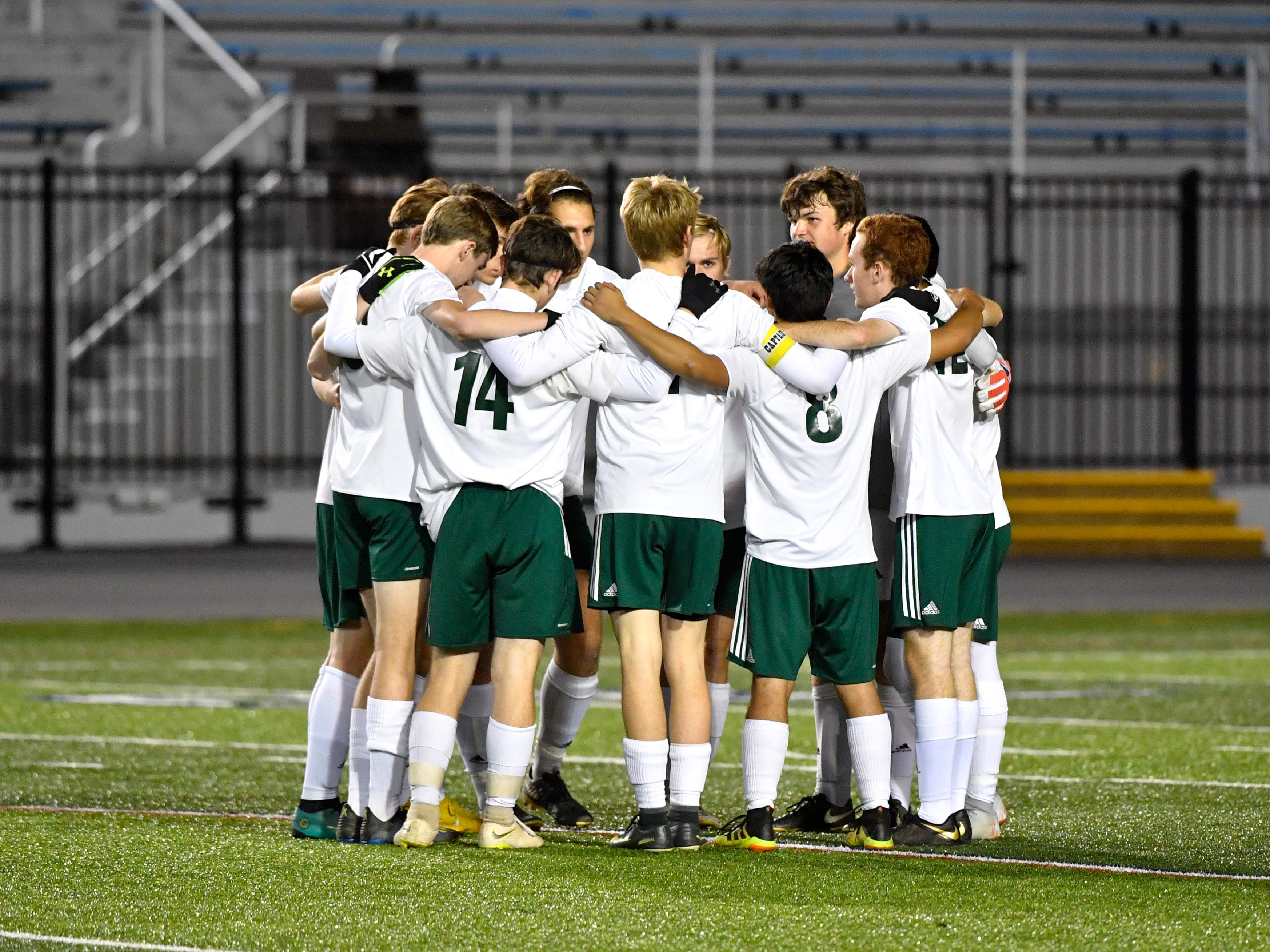 York Catholic huddles up before kick off to start the District 3 Class 1A boys' soccer finals between York Catholic and Camp Hill at Hersheypark Stadium, October 31, 2018. The Lions beat the Fighting Irish 2-0.
