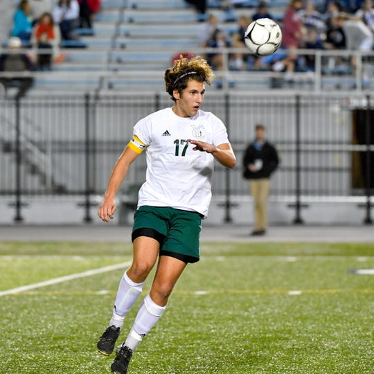 York Catholic's Nick Demarco (17) controls the ball during the District 3 Class 1A boys' soccer finals between York Catholic and Camp Hill at Hersheypark Stadium, October 31, 2018. The Lions beat the Fighting Irish 2-0.
