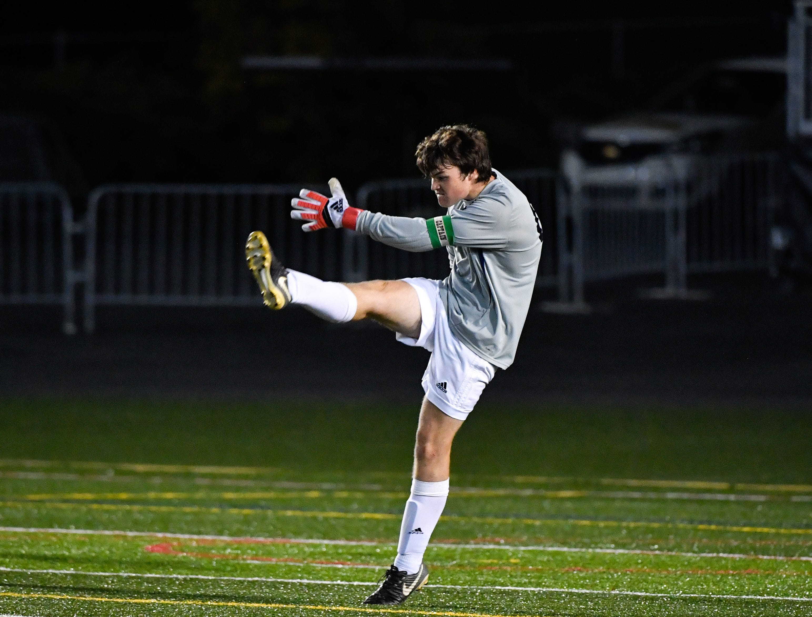 Ethan Higgins (00) of York Catholic punts the ball during the District 3 Class 1A boys' soccer finals between York Catholic and Camp Hill at Hersheypark Stadium, October 31, 2018. The Lions beat the Fighting Irish 2-0.