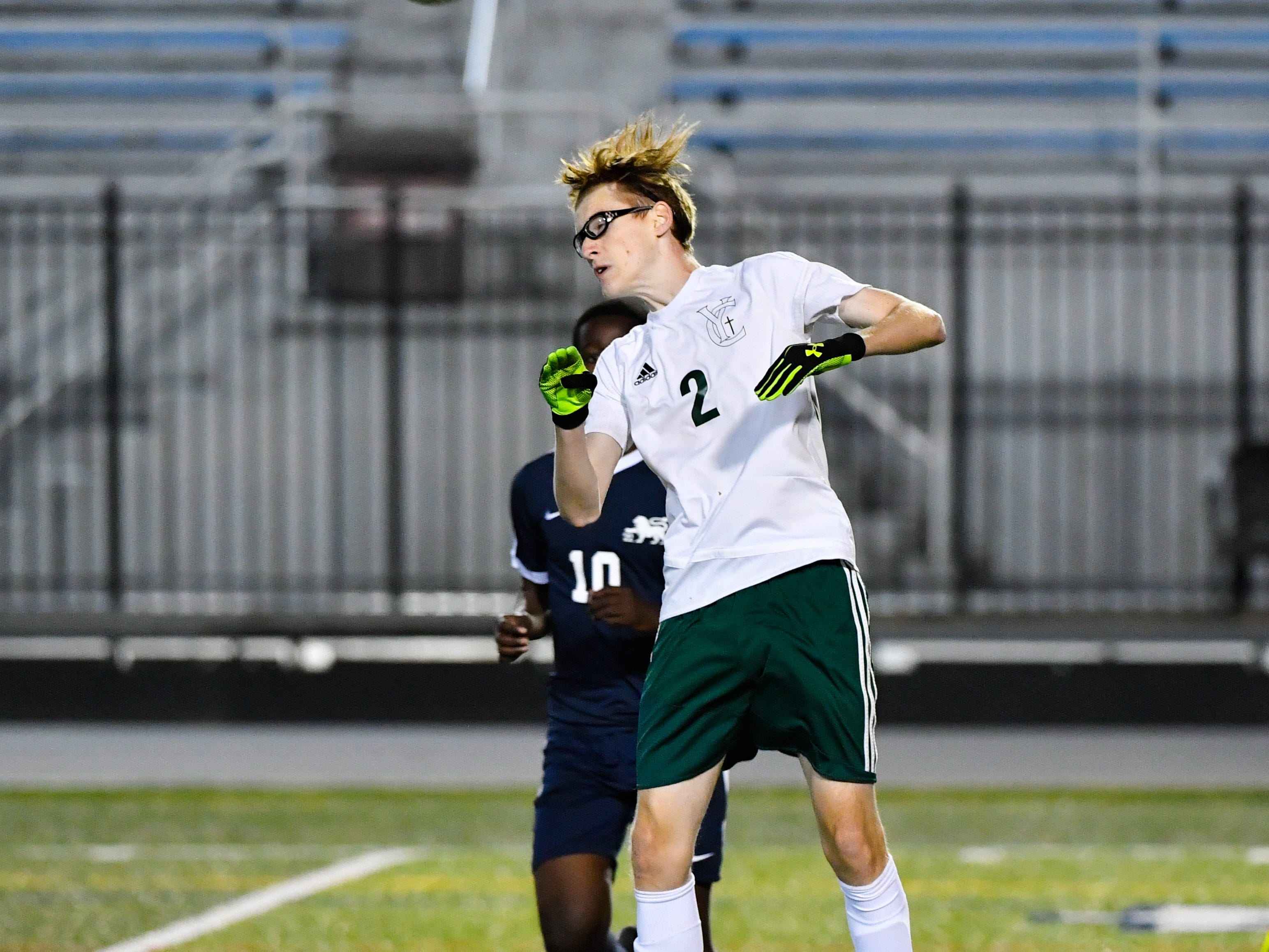 Phillip Jahn (2) deflects the ball during the District 3 Class 1A boys' soccer finals between York Catholic and Camp Hill at Hersheypark Stadium, October 31, 2018. The Lions beat the Fighting Irish 2-0.