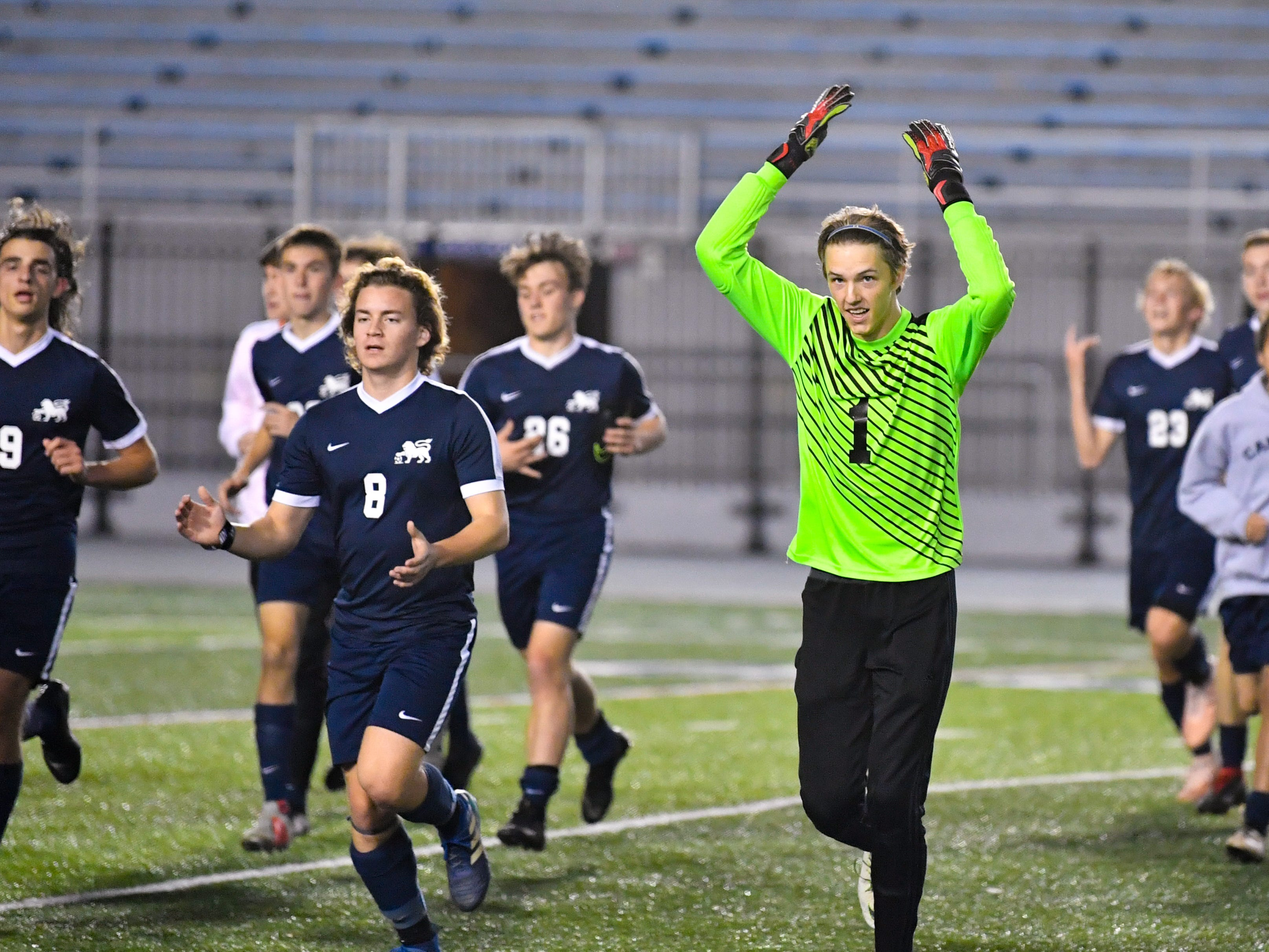 Camp Hill takes a victory lap after the District 3 Class 1A boys' soccer finals between York Catholic and Camp Hill at Hersheypark Stadium, October 31, 2018. The Lions beat the Fighting Irish 2-0.