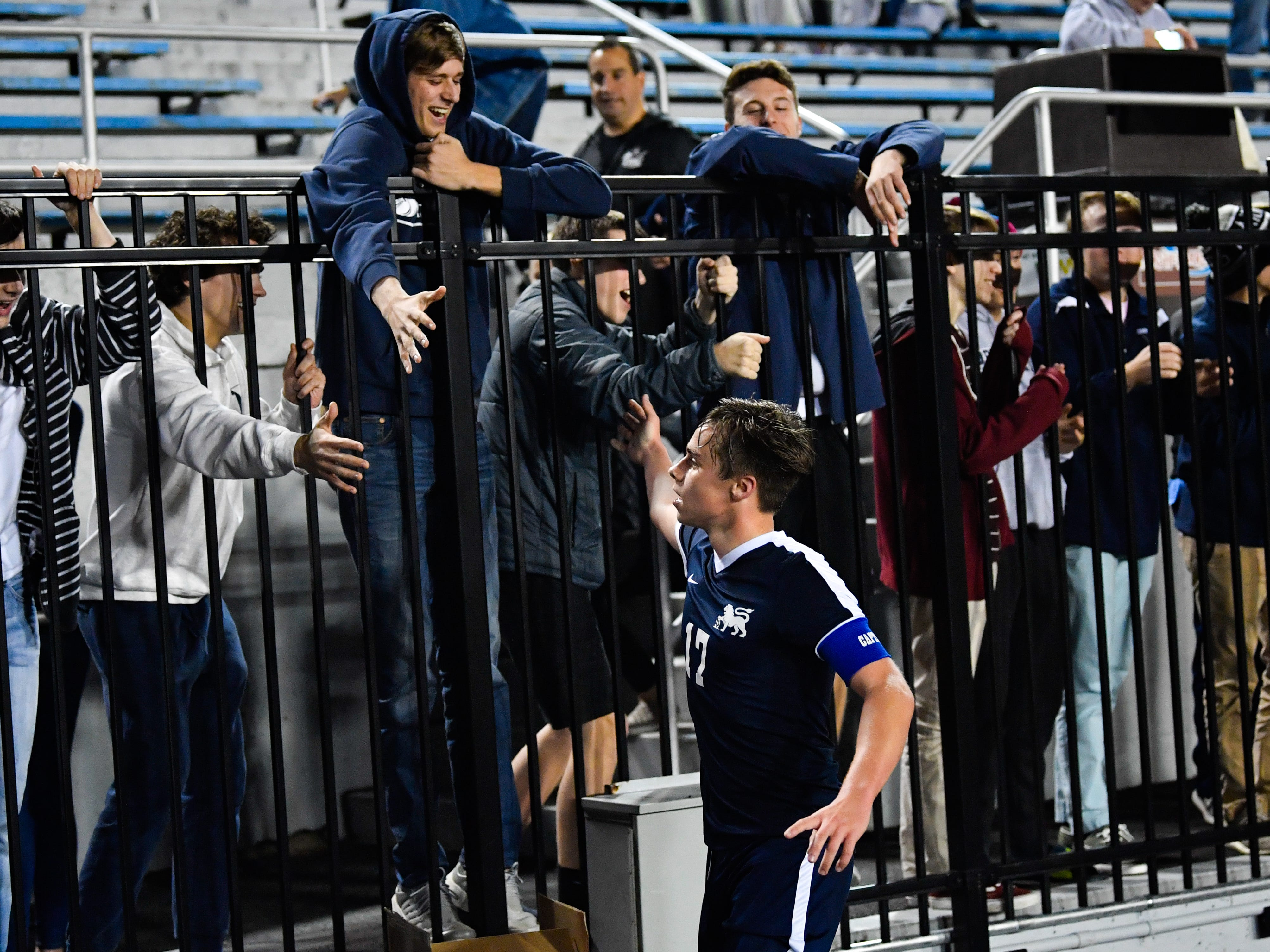 Camp Hill celebrates with their fans after the District 3 Class 1A boys' soccer finals between York Catholic and Camp Hill at Hersheypark Stadium, October 31, 2018. The Lions beat the Fighting Irish 2-0.