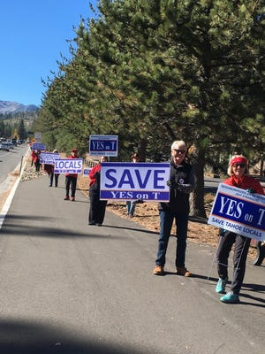 Members of the Tahoe Neighborhoods Group campaign for Measure T. The ballot initiative aims to phase out Airbnb, vacation rentals in South Lake Tahoe's residential areas.