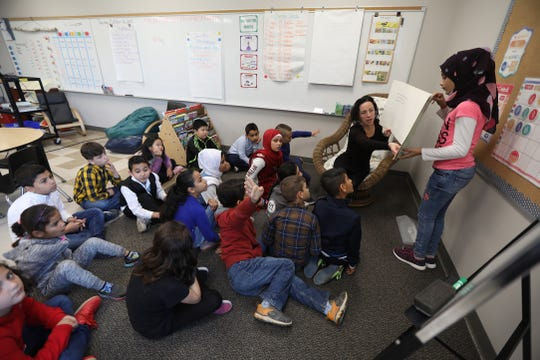 Heather Meloche works with her students in grades three through five in the English as a second language class.