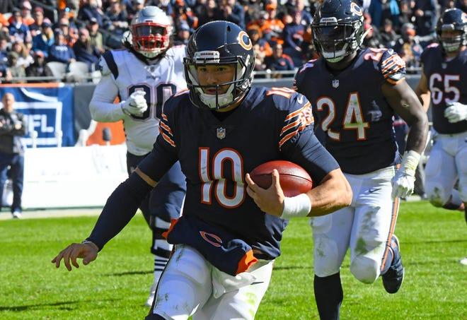 Chicago Bears quarterback Mitchell Trubisky (10) rushes the ball against the New England Patriots.