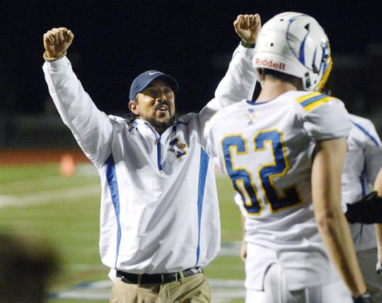 Irondequoit head coach Dan Fichter celebrates the Eagles' 28-21 win over Victor during a regular season game on Sept. 23. The teams meet again on Friday night for the Section V Class A championship.