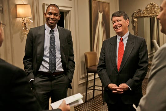 Republican U.S. Rep. John Faso, right, and his Democratic challenger, Antonio Delgado, establish ground rules before the start of a candidate forum in Poughkeepsie, N.Y., Wednesday, Oct. 17, 2018.