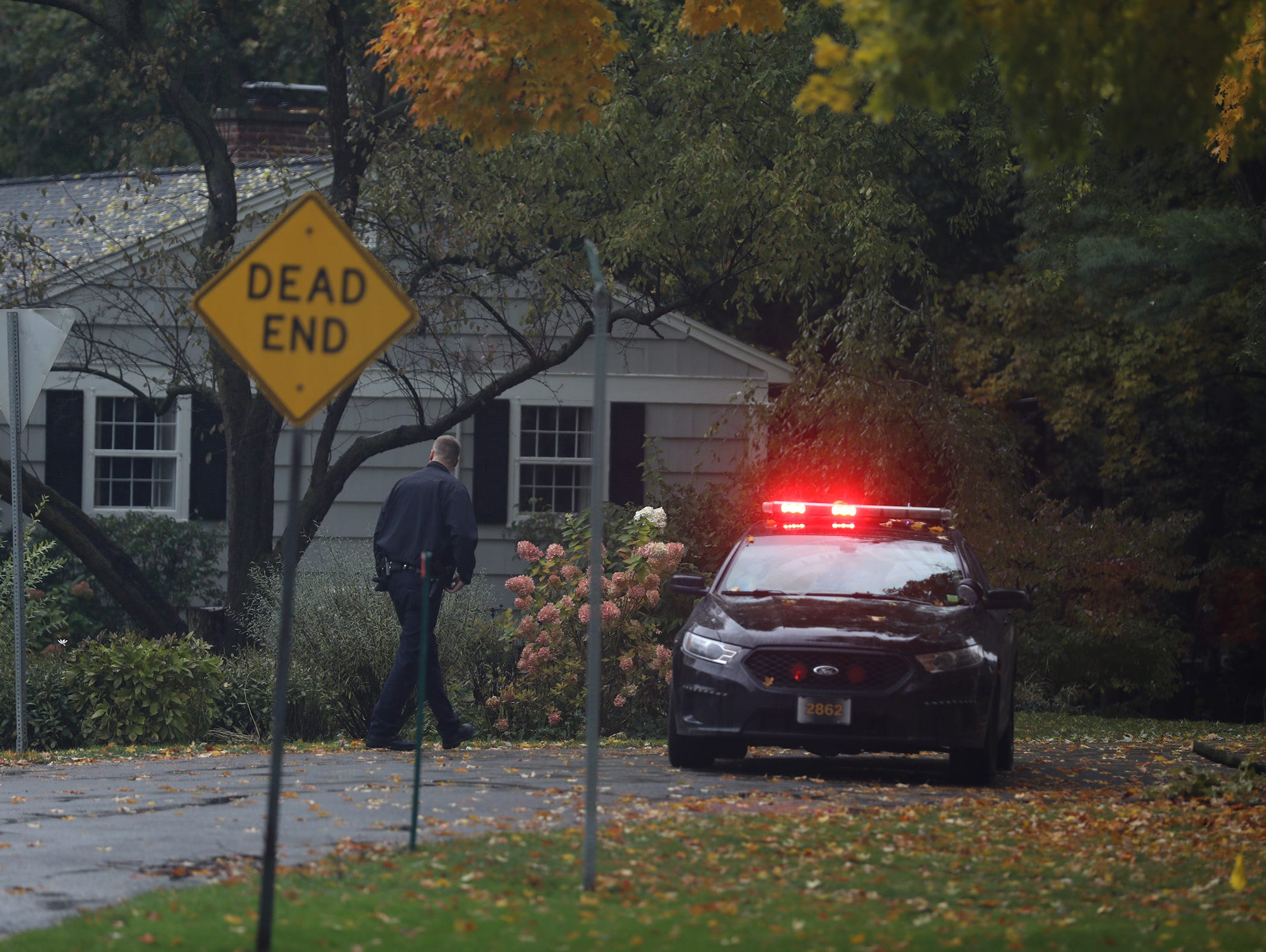 A woman was killed in her home on Collingsworth Drive in Penfield, Oct. 31, 2018.  Deputies block off the entry onto the street while they investigate.