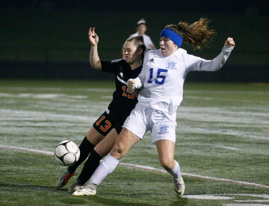 Marion's Chloe DeLyser and Wheatland-Chili's Hannah Beldue in the first half at Penfield High School.