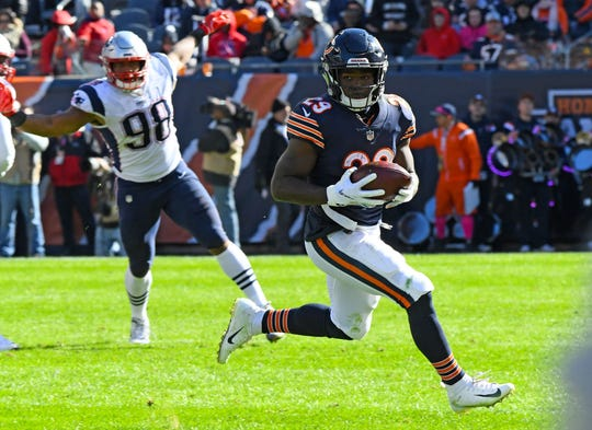 Chicago Bears running back Tarik Cohen (29) rushes the ball against the New England Patriots.