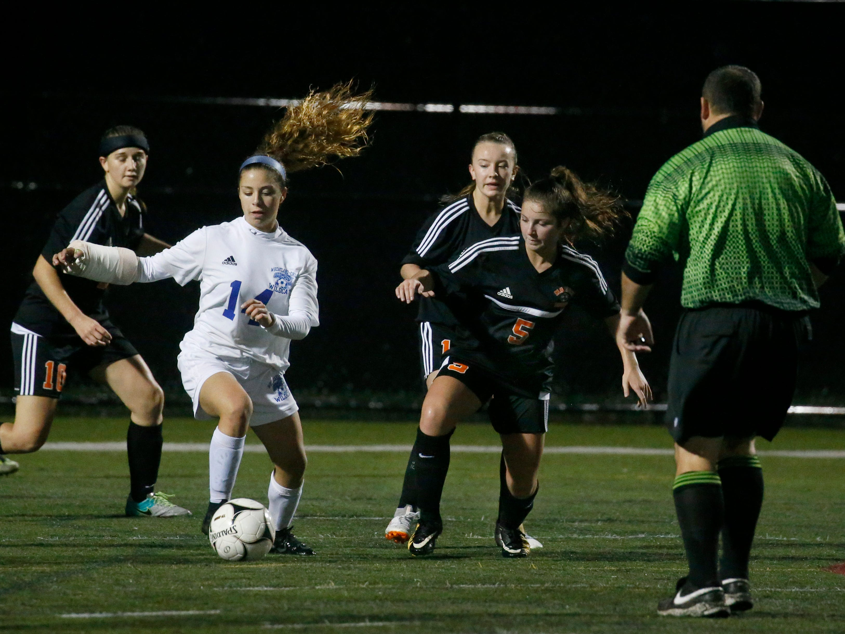 Wheatland-Chili's Niyah Rosado dribbles away from Marion's Beata Hanhisalo in the first half at Penfield High School.
