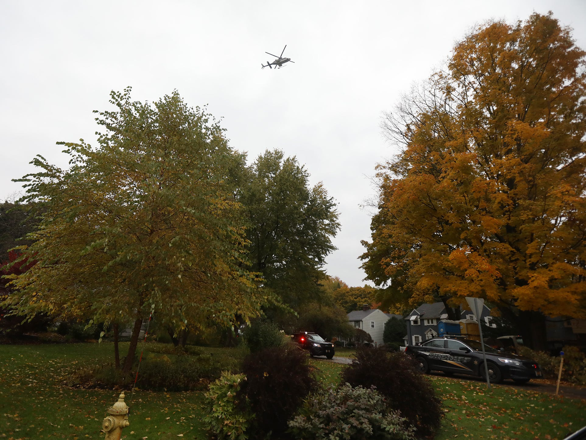 A New York State Police helicopter is used in the homicide investigation on Collingsworth Drive in Penfield.