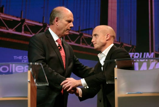 Republican Rep. Dan Donovan, left, and his Democratic challenger for the 11th Congressional District seat, Max Rose, shake hands after a debate at the College of Staten Island's Williamson Theater in New York, Tuesday Oct. 16, 2018.