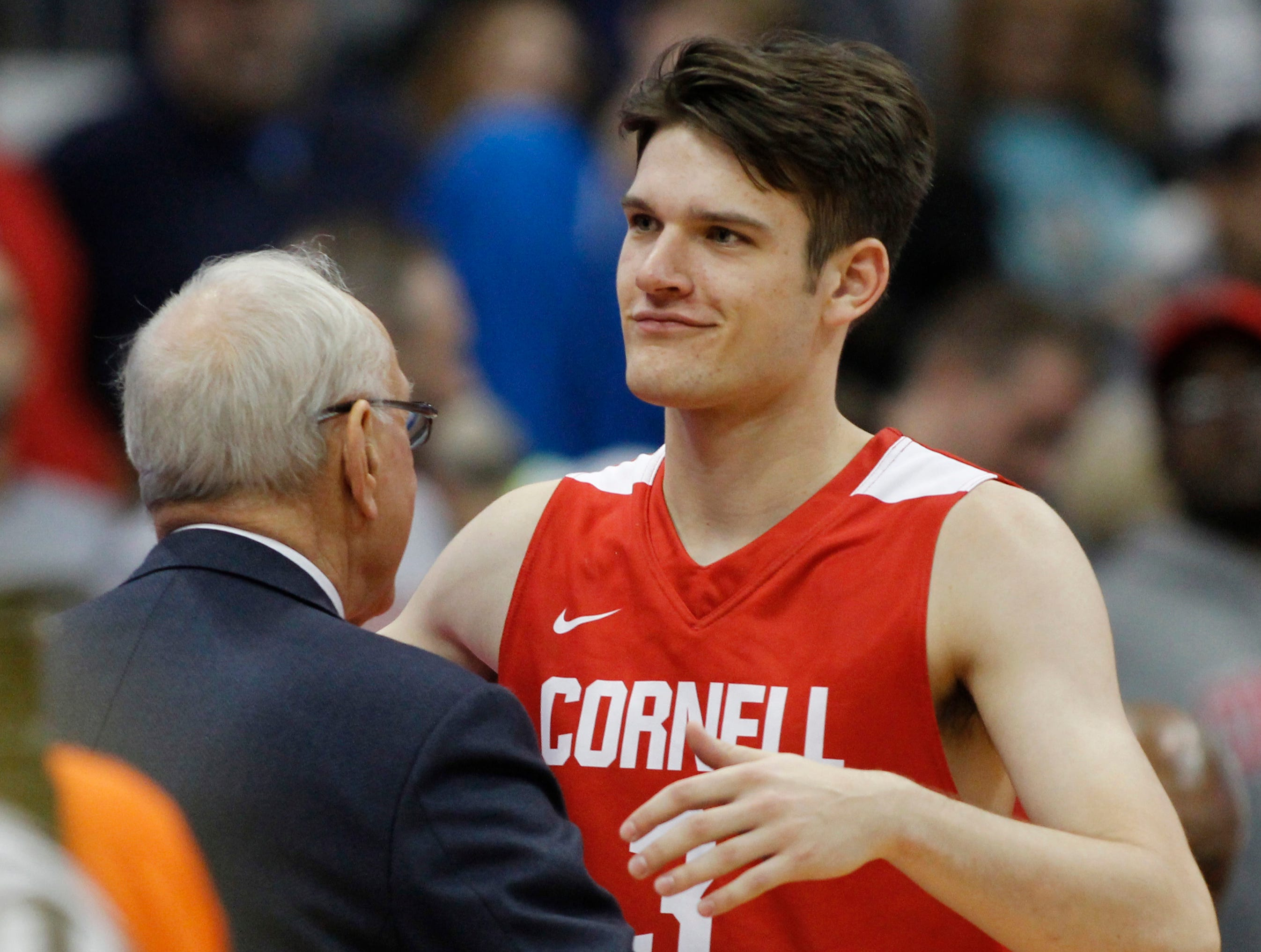 Syracuse head coach Jim Boeheim left, congratulates his son Cornell's Jimmy Boeheim at the end of an NCAA college basketball game in Syracuse, N.Y., Friday, Nov. 10, 2017. Cornell returns to the dome Dec. 1 and this time Jimmy will be facing his dad and his younger brother, Buddy, a 6-5 freshman guard for the Orange.