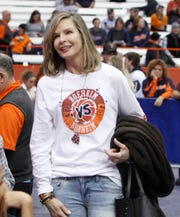 Juli Boeheim, right, wife of Syracuse head coach Jim Boeheim and mother of Cornell player Jimmy Boeheim, talks with fans before the start of a game Friday, Nov. 10, 2017. Boeheim is wearing a specially made shirt to commemorate this game where her husband is coaching Syracuse and her son is playing for Cornell.