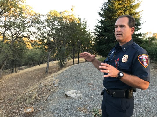 Redding Fire Marshal Craig Wittner shows where crews turned a 96-acre greenbelt into defensible space behind Wasatch Drive and Fujiyama Way west of Buenaventura Boulevard and the Blue Gravel Mine Trail.