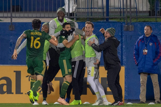 Portland Timbers midfielder Diego Valeri (8) celebrates a goal with his teammates in the second half agains FC Dallas at Toyota Stadium.