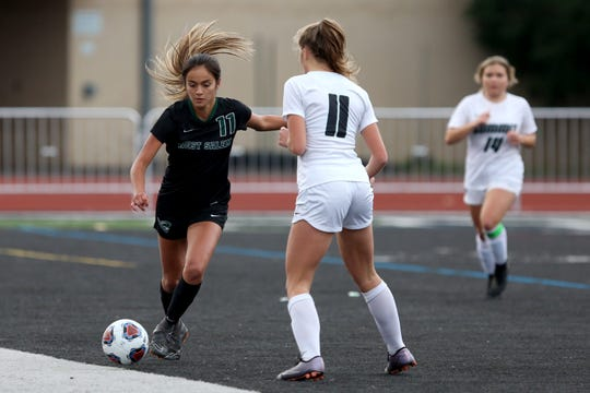 West Salem's Fatima Jimenez (11) controls the ball around Summit's Emma Brooks (11) during the OSAA girls soccer playoffs against Summit on Wednesday, Oct. 31, 2018, at West Salem High School.