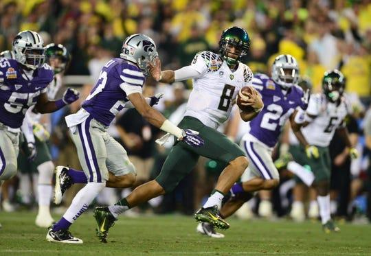 Oregon quarterback Marcus Mariota (8) runs for a touchdown against Kansas State during the Fiesta Bowl.