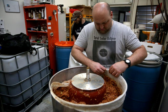 Divine Distillers owner, Jason Greenwood, demonstrates how he makes apple brandy on Wednesday, Oct. 31, 2018 at Divine Distillers.