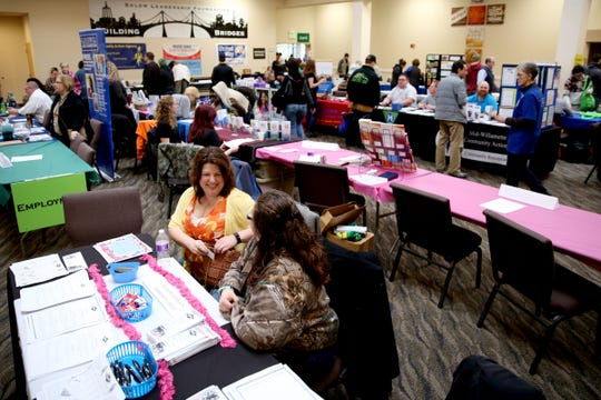 Representatives from different agencies meet with people during the 10th annual Marion County Community Homeless Connect at Salem First Baptist Church on March 27, 2018. The event featured 55 different service providers to give underserved people access to medical care, bike repair, pet grooming, clothing, sleeping bags, haircuts and more.