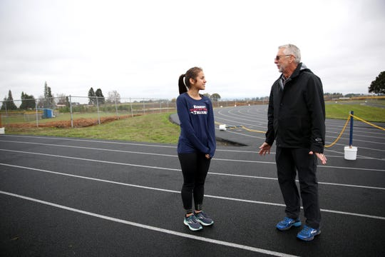 Alejandra Lopez talks with Kennedy cross country coach Steve Ritchie on Wednesday, Oct. 31, 2018, in Mt. Angel. Lopez placed fifth in the 3A/2A/1A state meet last year.