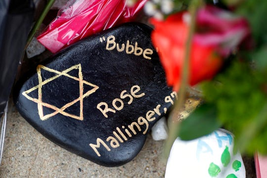 This photo shows a painted rock in memory of Rose Mallinger, 97, Wednesday, Oct. 31, 2018, part of a makeshift memorial outside the Tree of Life Synagogue in the Squirrel Hill neighborhood of Pittsburgh, to the 11 people killed during worship services Saturday.