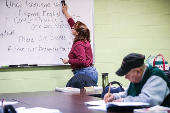 Tricia Santana, a instructor, erases the previous lesson from the board  Thursday, Nov. 1, 2018, at Adult Literacy Council of the Concho Valley.