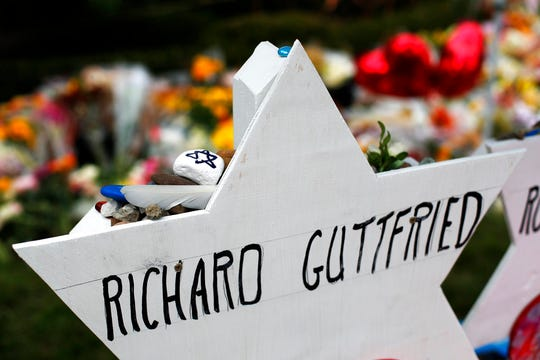 This photo shows a memorial to Richard Guttried, on Wednesday, Oct. 31, 2018, part of a makeshift memorial outside the Tree of Life Synagogue to the 11 people killed during worship services Saturday in Pittsburgh.