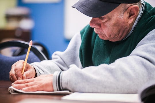Jesus Reyes Orozco writes out answers for an English lesson Thursday, Nov. 1, 2018, at Adult Literacy Council of the Concho Valley.