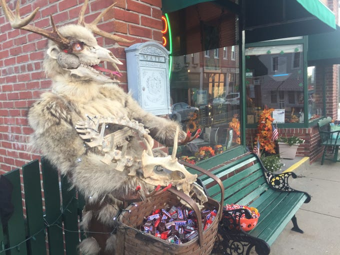 A monster outside the Blarney Stone Pub in Onancock is set to offer candy to Halloween trick-or-treaters in Onancock, Virginia on Wednesday, Oct. 31, 2018. The town encouraged downtown businesses to participate in trick-or-treating.
