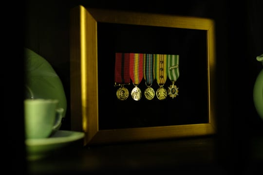 A U.S. marine gave Thinh Pham, owner of Minh's Bistro in Rehoboth Beach, some of his war medals. Pham expresses gratitude toward any veteran who visits his restaurant.