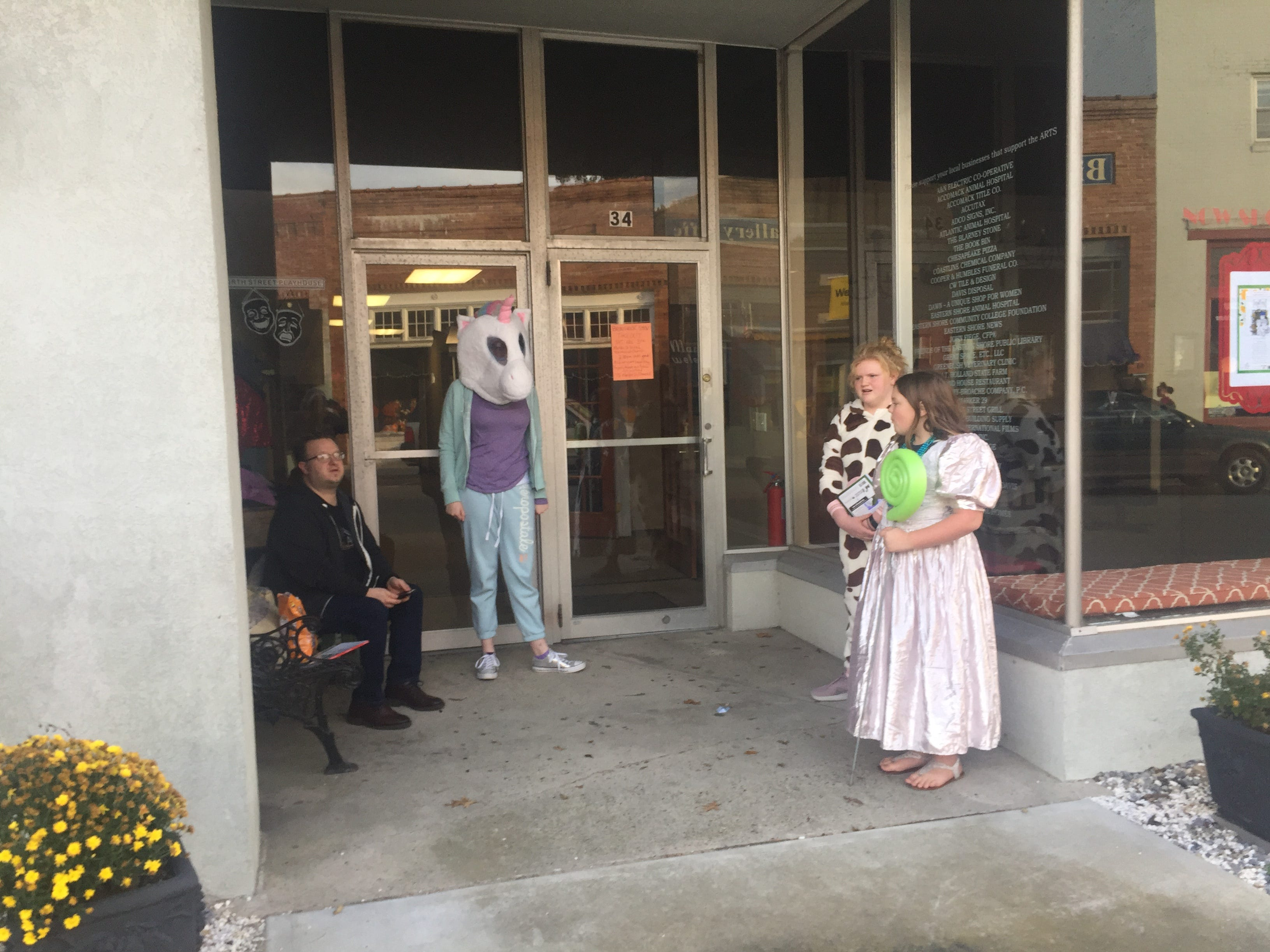 North Street Playhouse volunteers prepare to hand out candy to Halloween trick-or-treaters in Onancock, Virginia on Wednesday, Oct. 31, 2018.