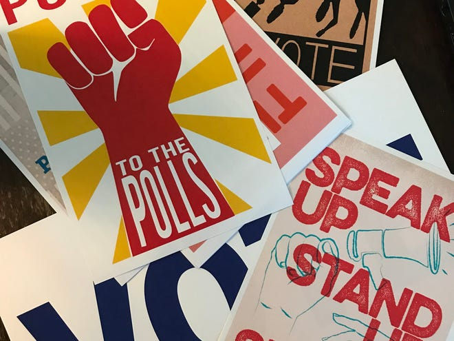Posters encouraging people to vote