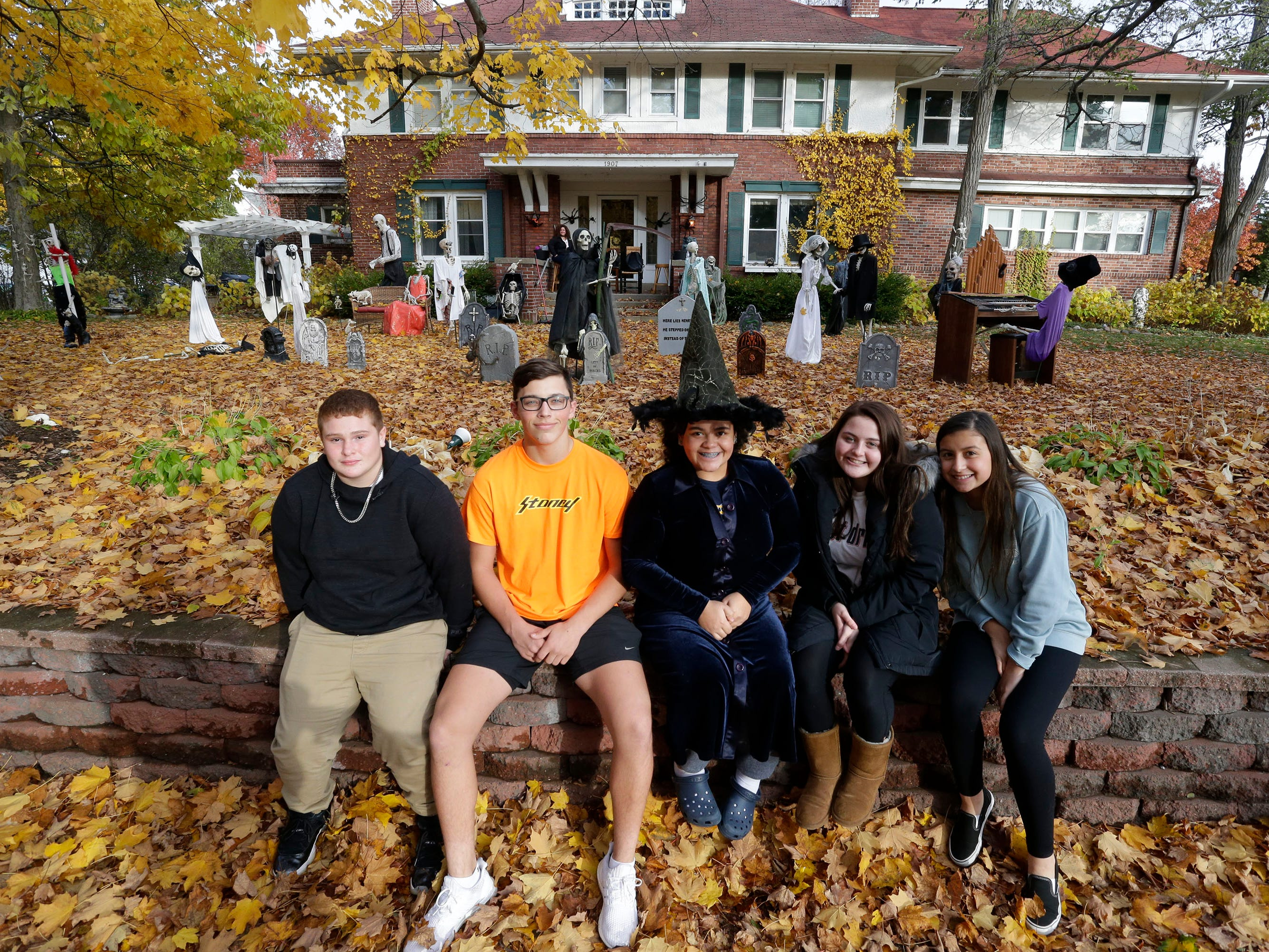 Getting ready for Trick or Treat from left are Kyle Wood, Karter Bell, Yanni Rivera, Jessica Fritz and Naomi Mendez, , Wednesday, October 31, 2018, in Sheboygan, Wis.  They were going to hand out treats at the Sarah Fritz home.