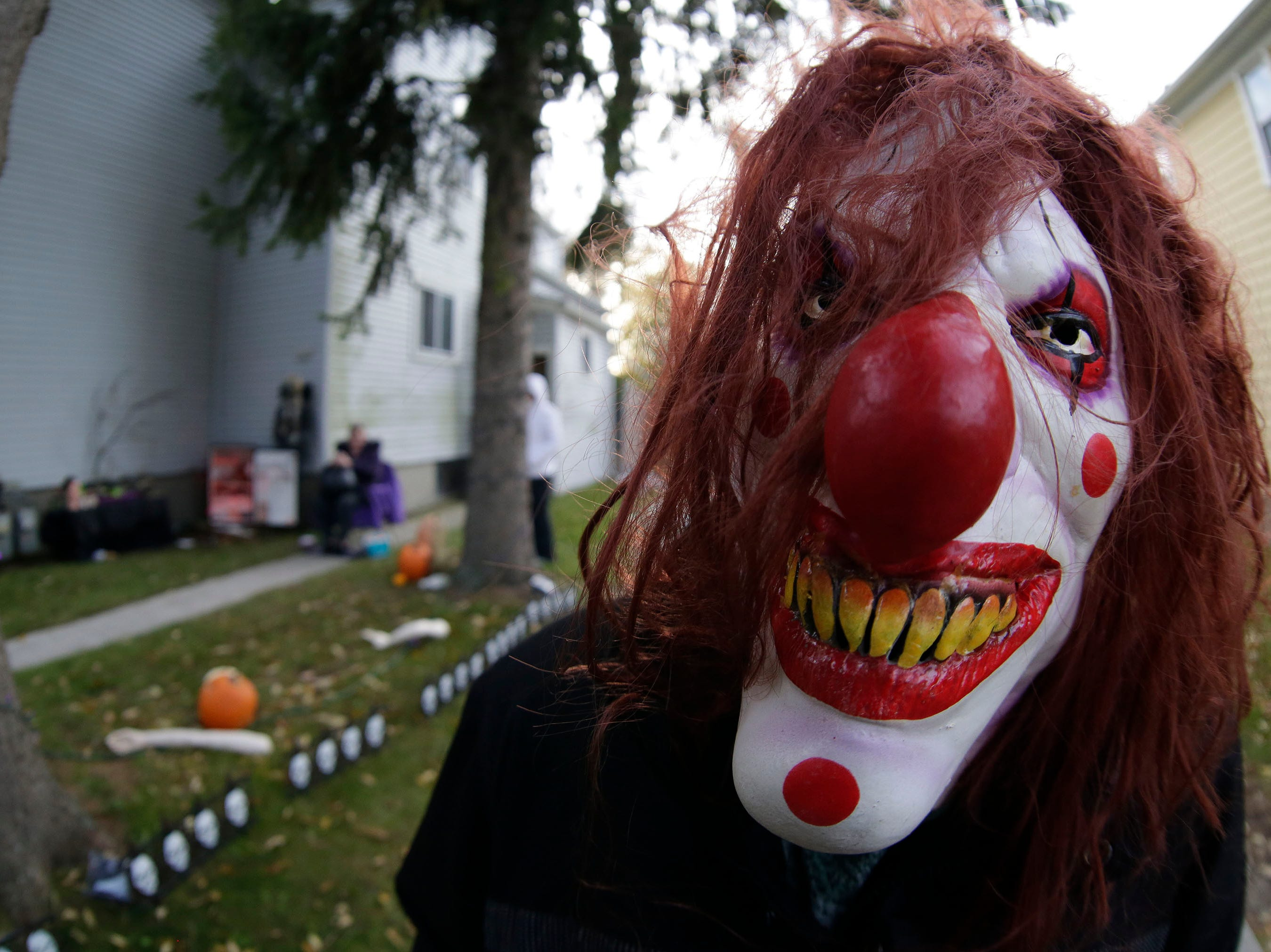 Charis Nery of Sheboygan is ready to scare youngsters of all ages during Trick or Treat, Wednesday, October 31, 2018, in Sheboygan, Wis.