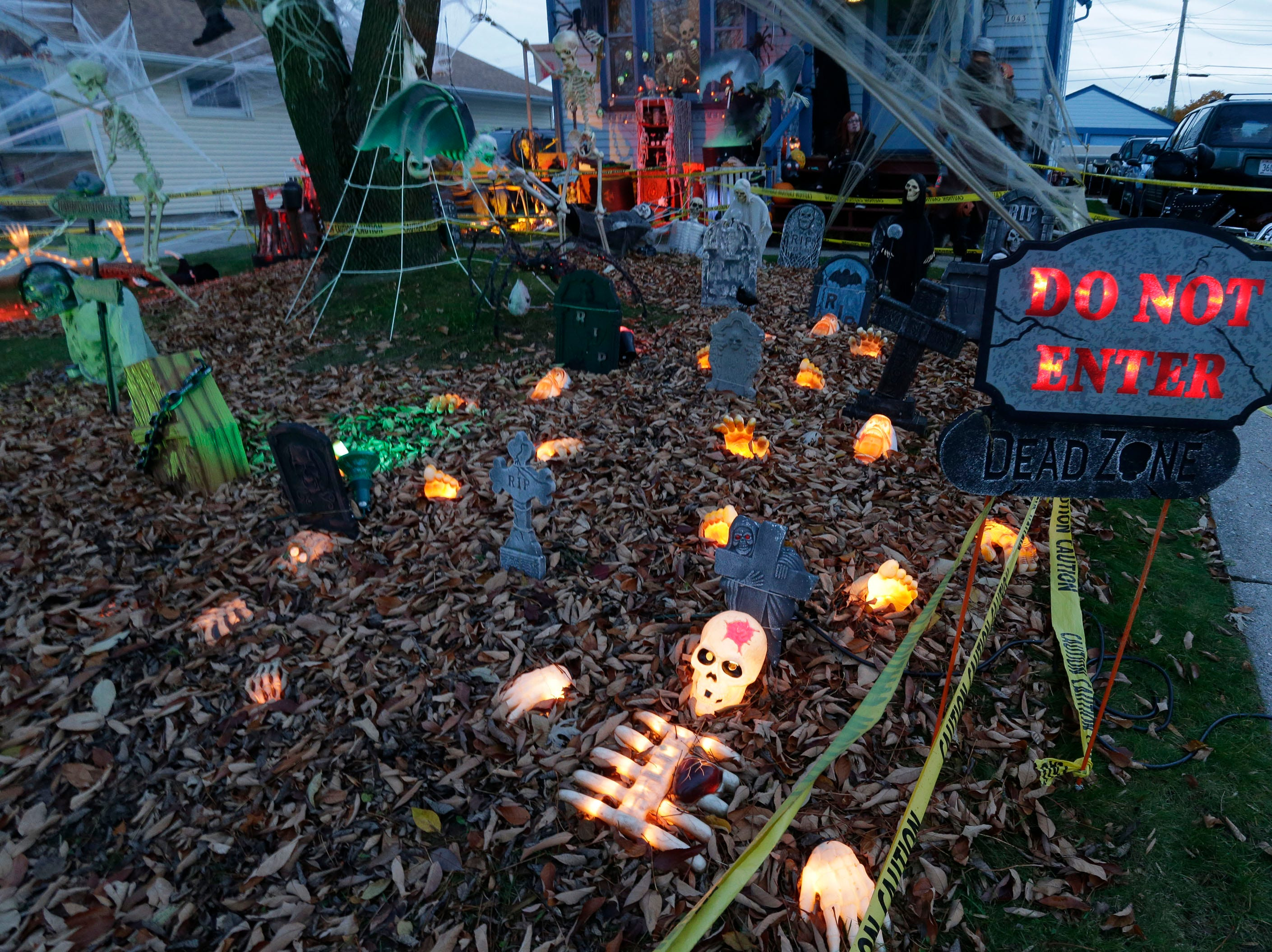 Halloween lights glow at the Ron and Jill Thill home during Trick or Treat, Wednesday, October 31, 2018, in Sheboygan, Wis.