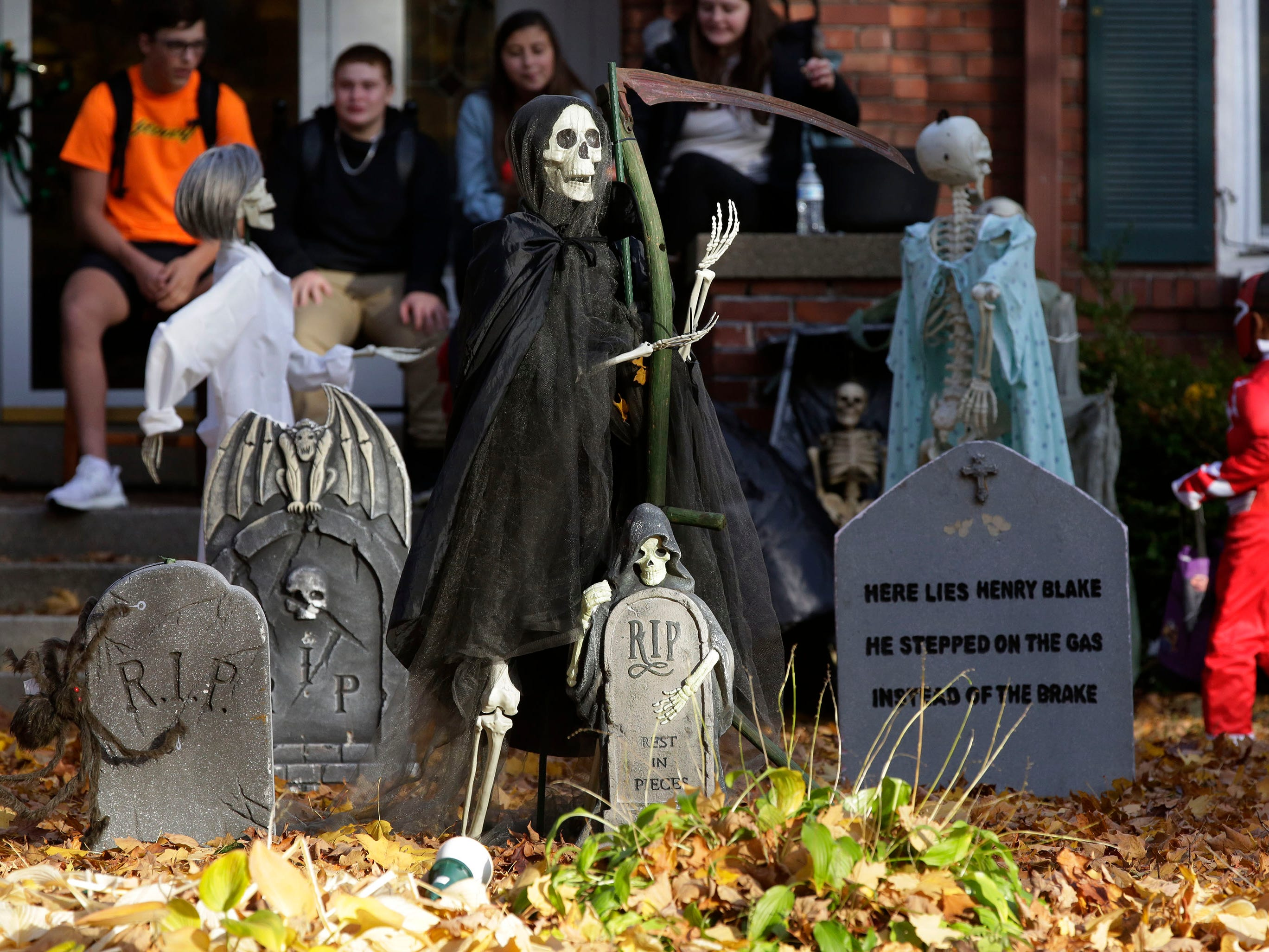 Scary tombstones and a skeleton are a feature of the front yard of Sarah Fritz during Trick or Treat, Wednesday, October 31, 2018, in Sheboygan, Wis.