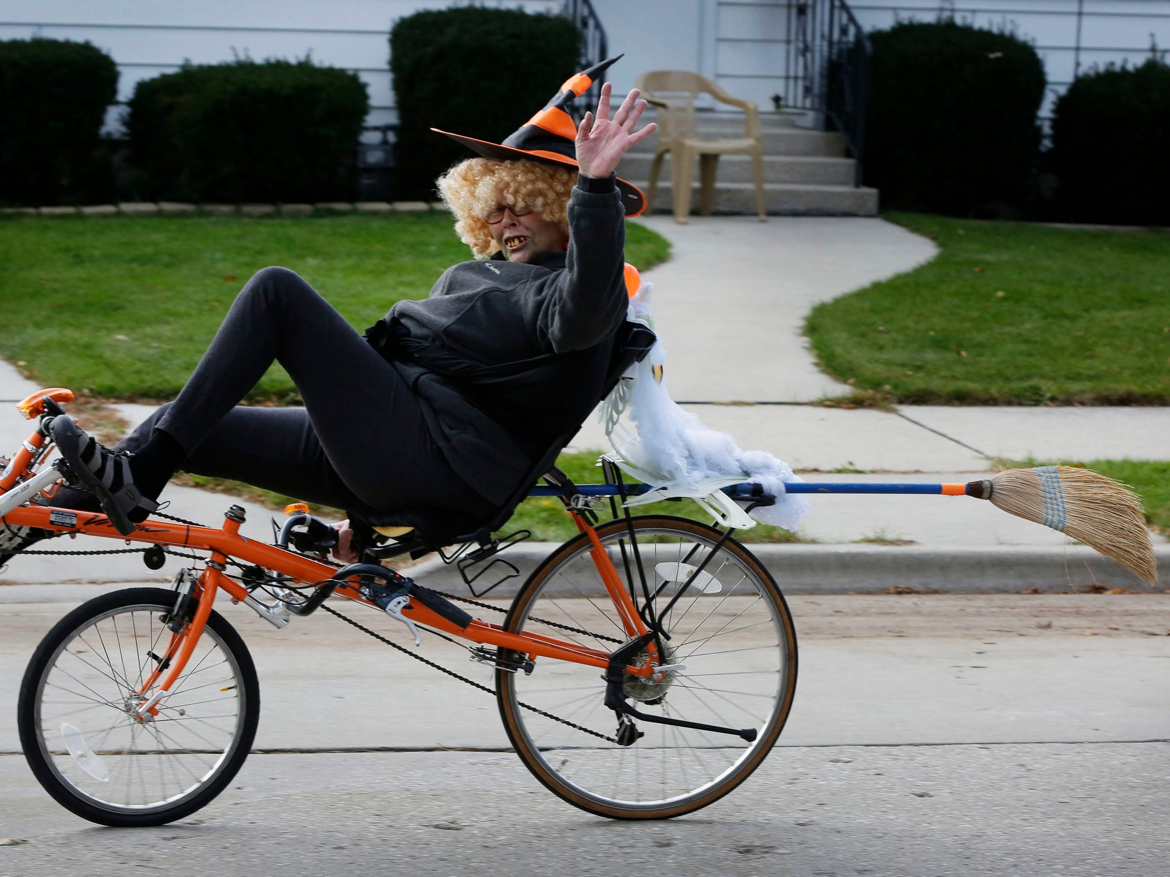 Joy Schildbach rides her bicycle as a witch during Trick or Treat, Wednesday, October 31, 2018, in Sheboygan, Wis.