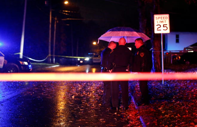 Springfield police investigating an overnight shooting on East Locust Street in November 2018. The shooter killed two people and injured two others.