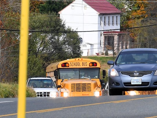 A school bus travels along U.S. 11 through Verona on Thursday afternoon, Nov. 1, 2018.