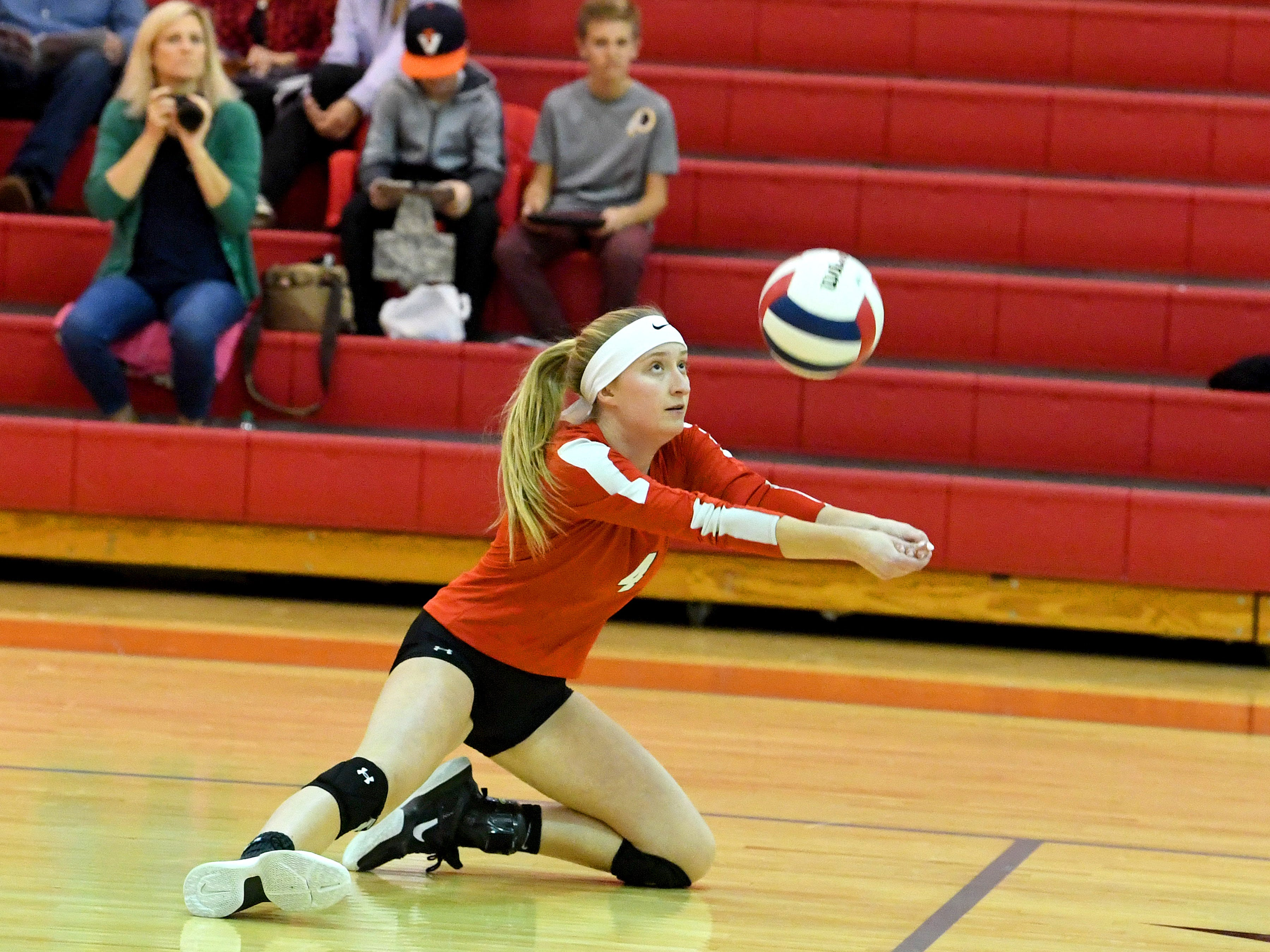 Riverheads' Emma Tomlinson drops to the side and down on a knee to bump the ball during a Region 1B quarterfinal match, played in Greenville on Thursday, Nov. 1, 2018.