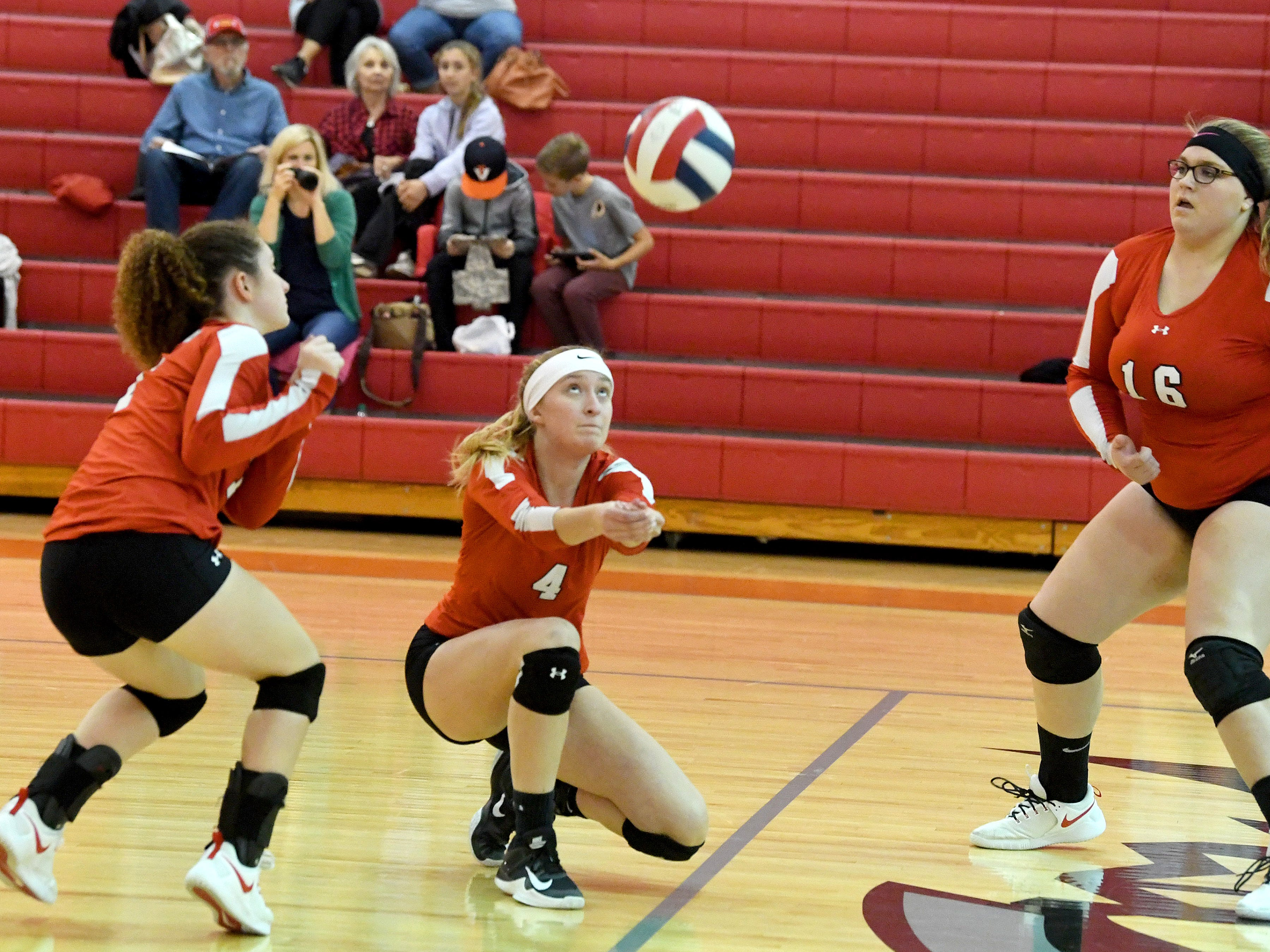 Riverheads' Emma Tomlinson drops low to bump the ball between teammates Gracie Fulton and Olivia Modlin during a Region 1B quarterfinal match, played in Greenville on Thursday, Nov. 1, 2018.