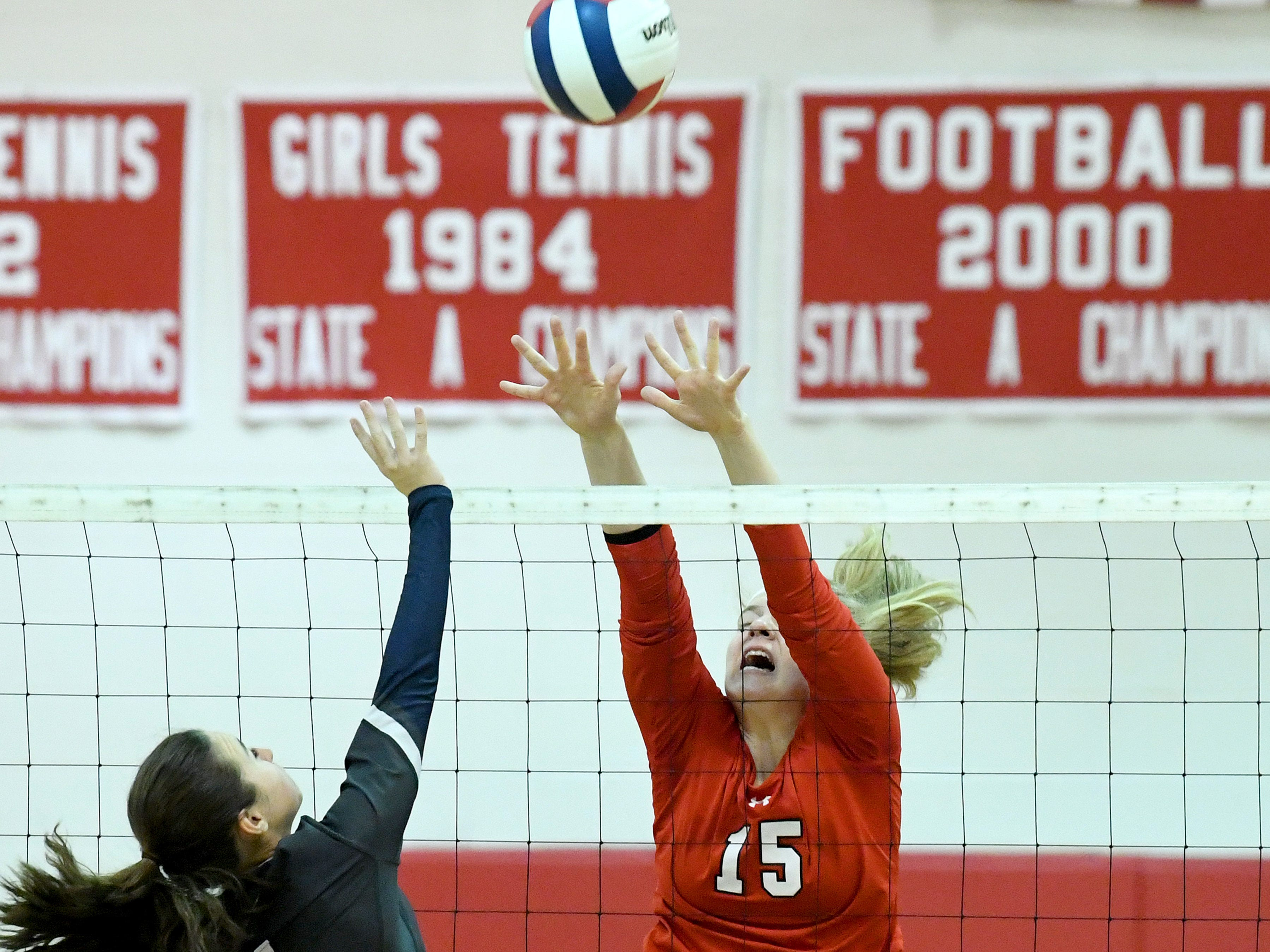 Riverheads' Eva Frederick tries to block a return at the net during a Region 1B quarterfinal match, played in Greenville on Thursday, Nov. 1, 2018.