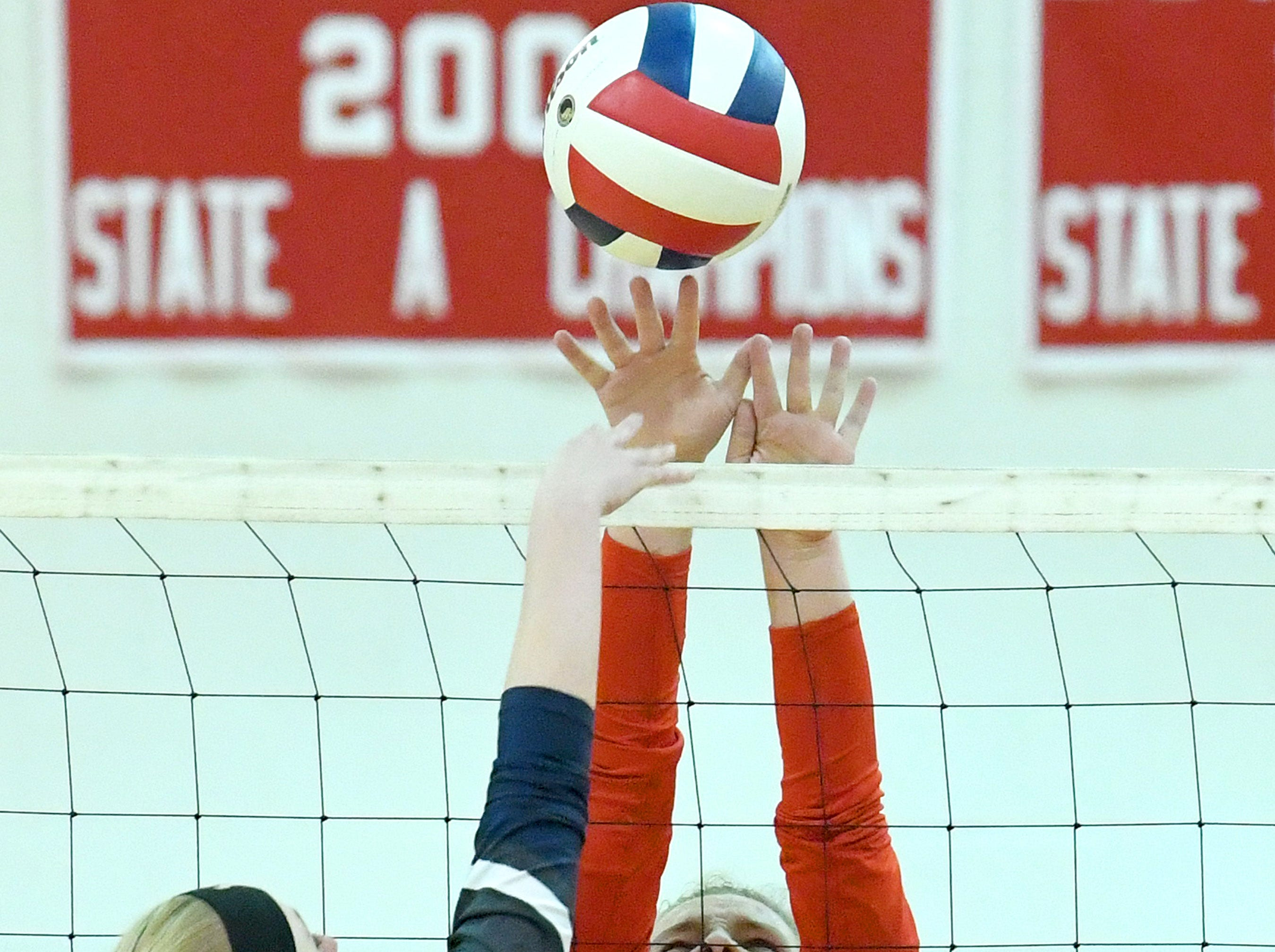 Riverheads' Dayton Moore blocks a return by William Campbell's Callie McFaden at the net during a Region 1B quarterfinal match, played in Greenville on Thursday, Nov. 1, 2018.