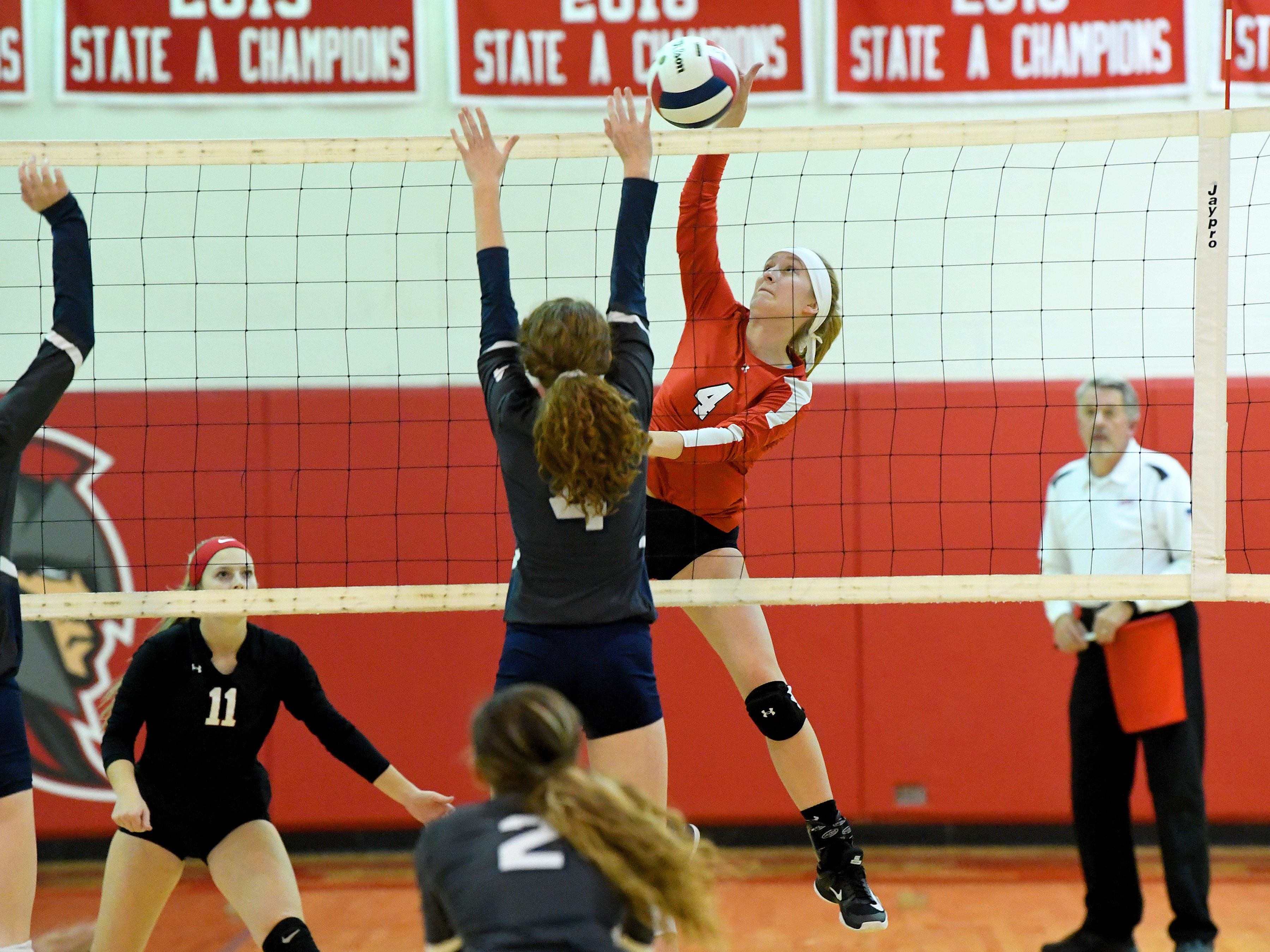 Riverheads' Emma Tomlinson hits the ball back across the net past William Campbell's Jonnah Williams during a Region 1B quarterfinal match, played in Greenville on Thursday, Nov. 1, 2018.