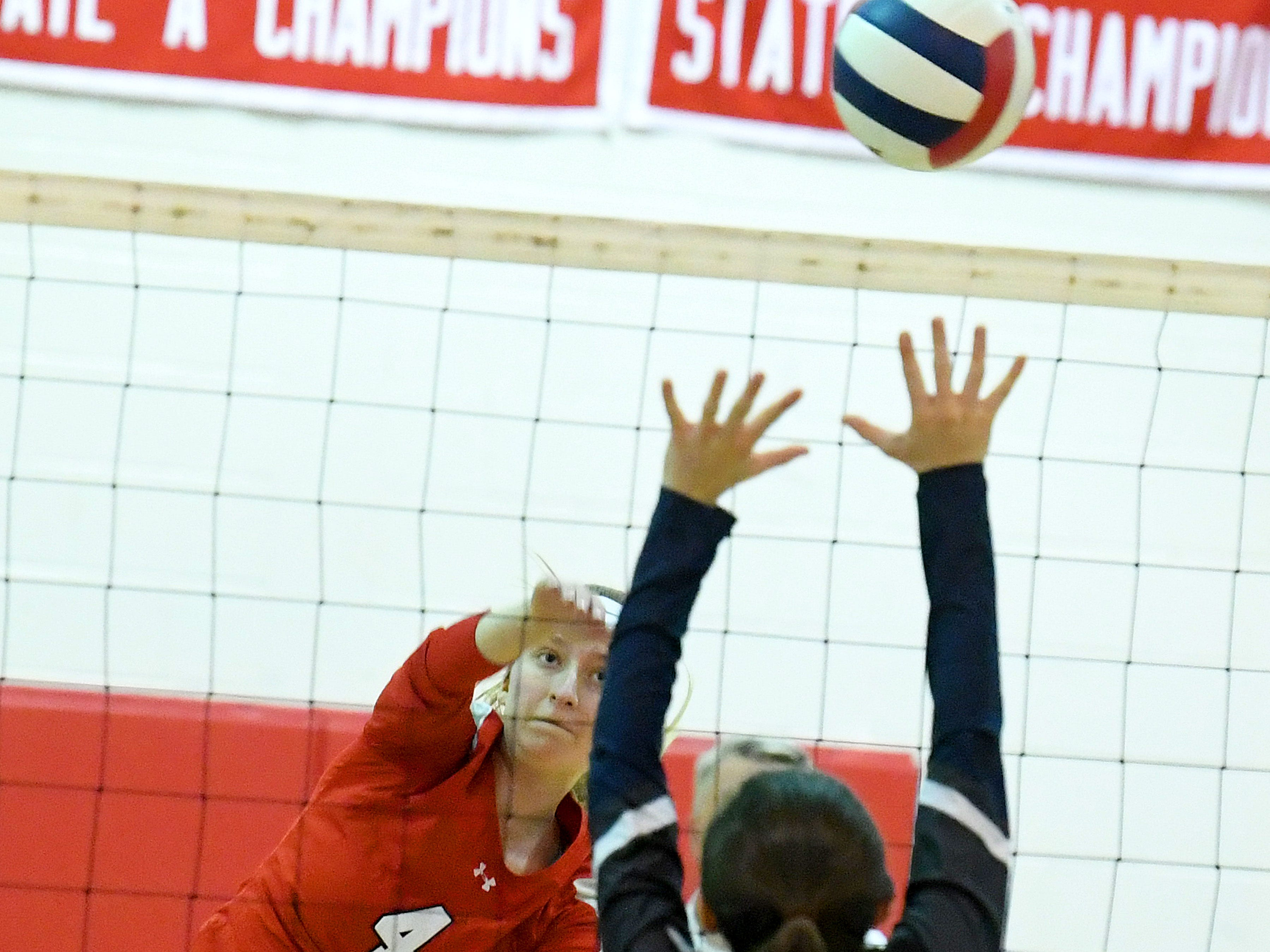 Riverheads' Emma Tomlinson spikes the ball across the net during a Region 1B quarterfinal match, played in Greenville on Thursday, Nov. 1, 2018.