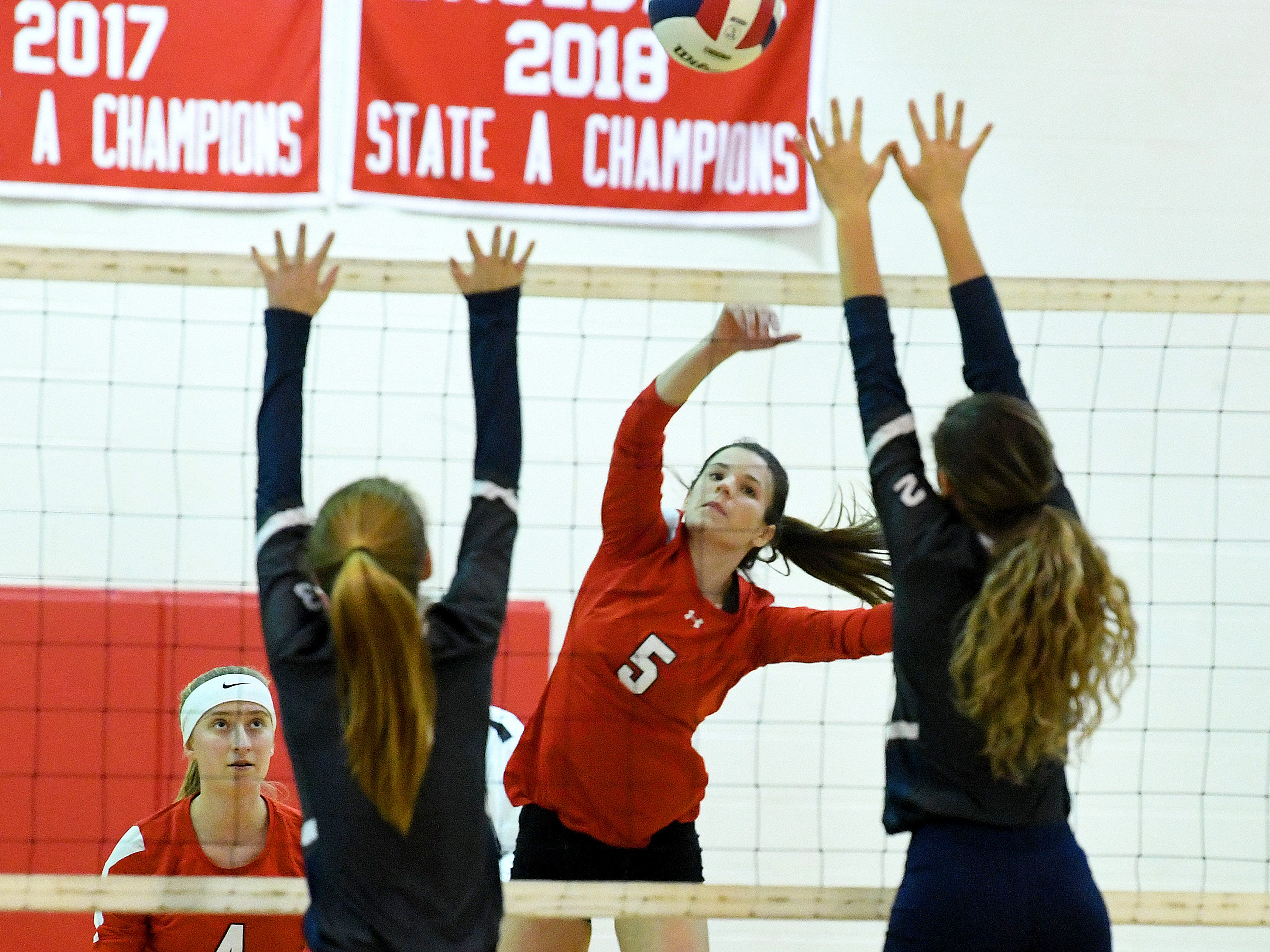 Riverheads' Abbey Eavers spikes the ball over the net and past William Campbell's Jodi Pool and Brentley Bomar during a Region 1B quarterfinal match, played in Greenville on Thursday, Nov. 1, 2018.
